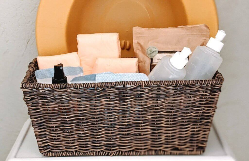 postpartum care kit on toilet filled with pads and peri bottles