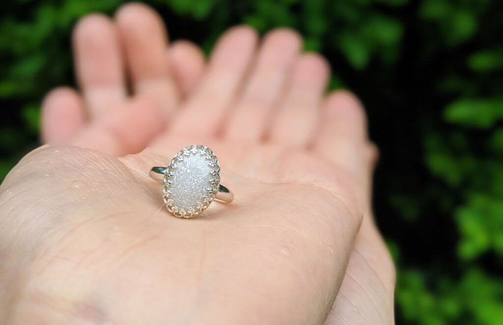 a breast milk ring made from a breast milk kit sitting in two hands