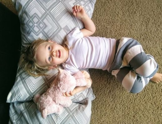 girl wearing peejamas laying down